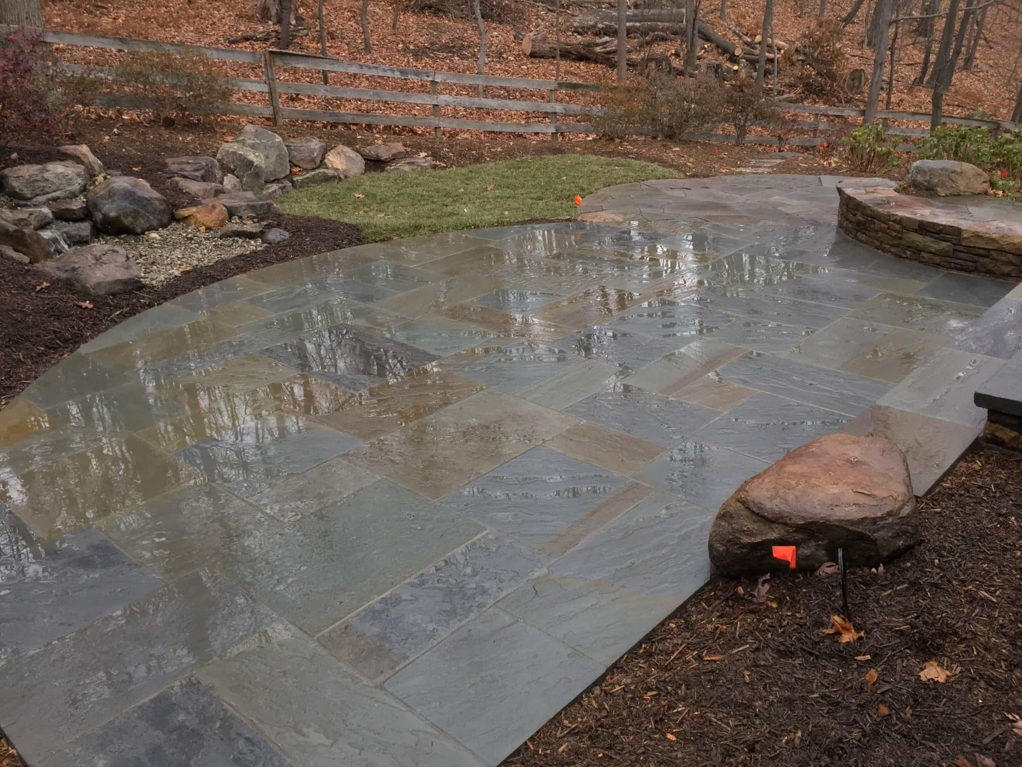 535 Flagstone Patio with PA Beige Stone Wall and Boulders