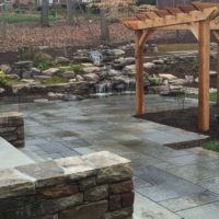 540 Flagstone Patio with Cedar Arbor and Waterfalls Built Into the Hillside
