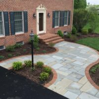 558 Gracious Flagstone Entry with Brick Edging