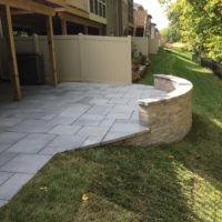562 Townhouse Patio in Techo-Bloc Aberdeen Azzurro Pavers with Curved Sitting Wall & Retaining Wall