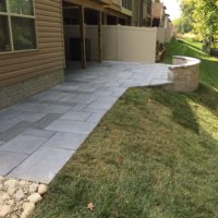 563 Townhouse Patio in Techo-Bloc Aberdeen Azzurro Pavers with Curvd Sitting & Retaining Wall