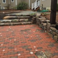 574 Rustic Brick Patio with Stone Inlay and Rustic Stone Walls