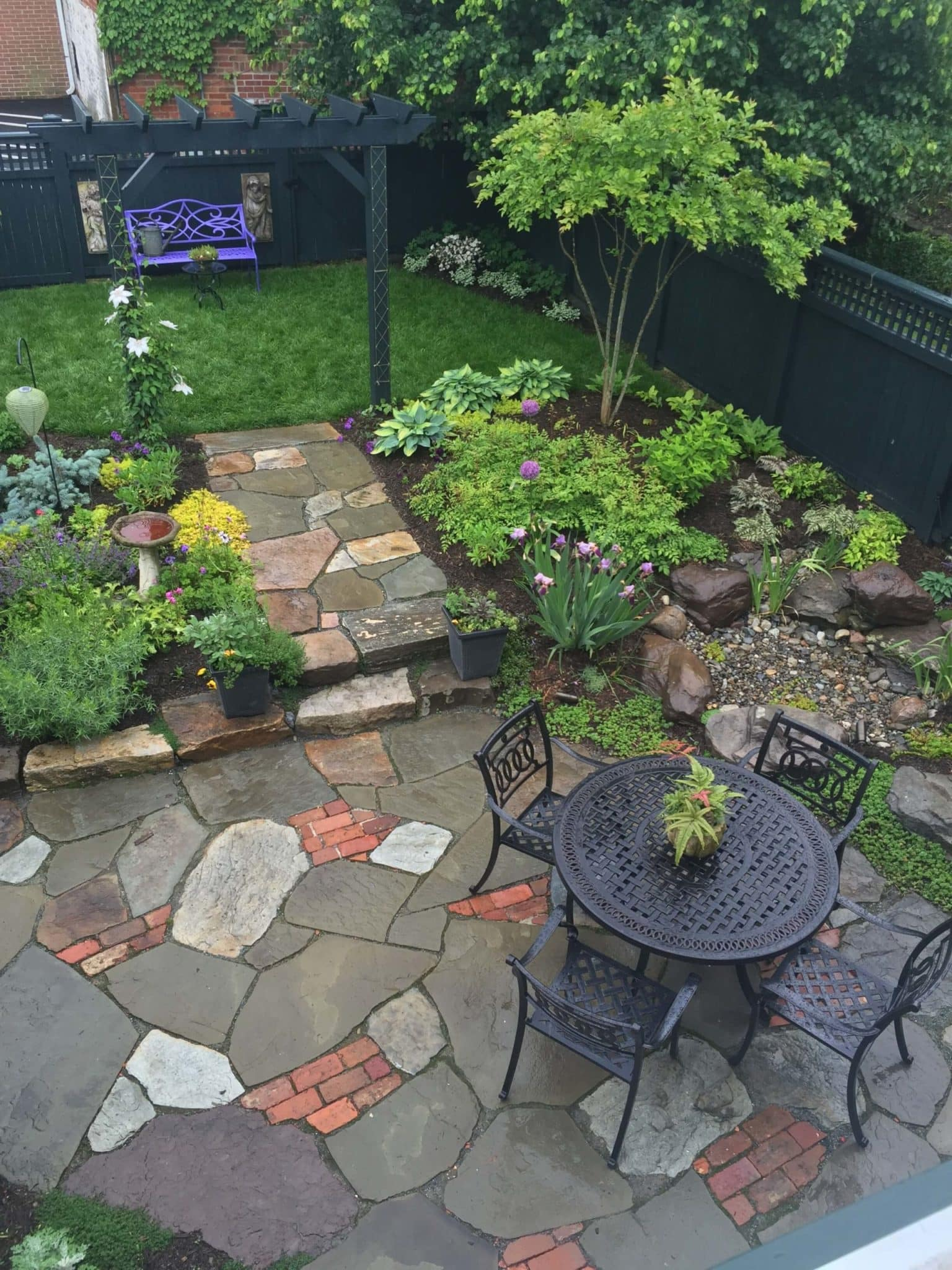 576 Informal Patio Featuring Irregular Flagstone, Salvaged Brick and Waterfeature