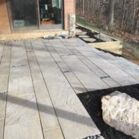 581 Lower Level, Under-Deck Patio with Techo-Bloc Aberdeen Pavers and Mexican Beach Pebbles