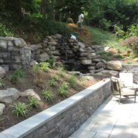 59 Stone Retaining Walls with Cap and Waterfall Built into Hillside