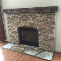 592 Renovated Fireplace with Rustic Wood Mantle