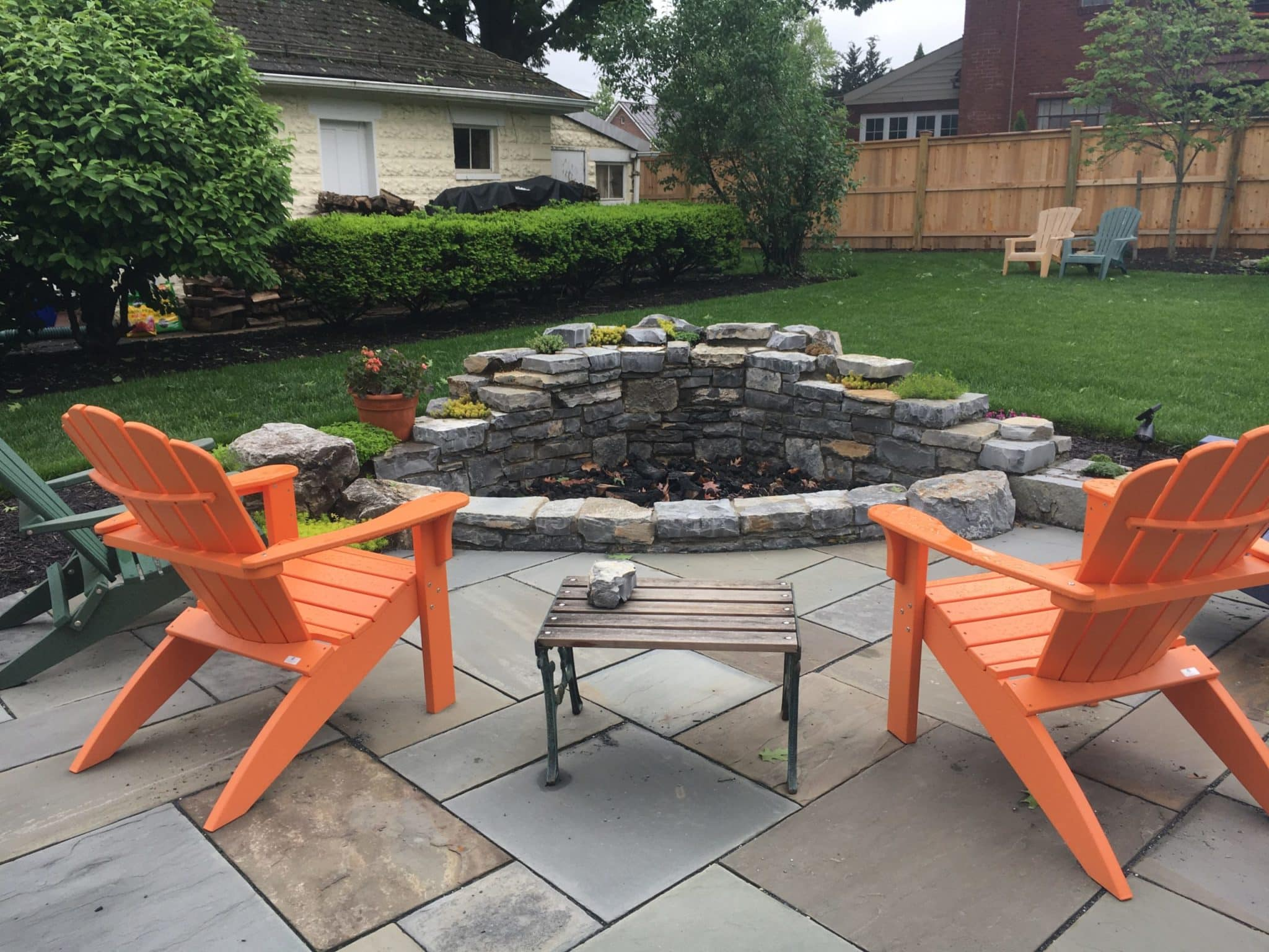 595 Double-Faced Stone Wall and Firepit with Alverson Limestone and Plant Pockets