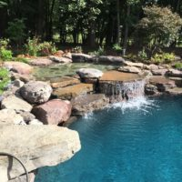606 Residential Pool with PA Boulder Waterfall and Naturalized Edge