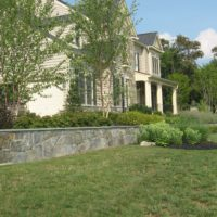 63 Stone Retaining Wall with Flagstone Cap