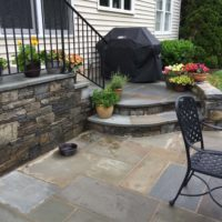 657 Curved Stone Steps From Grill to Patio