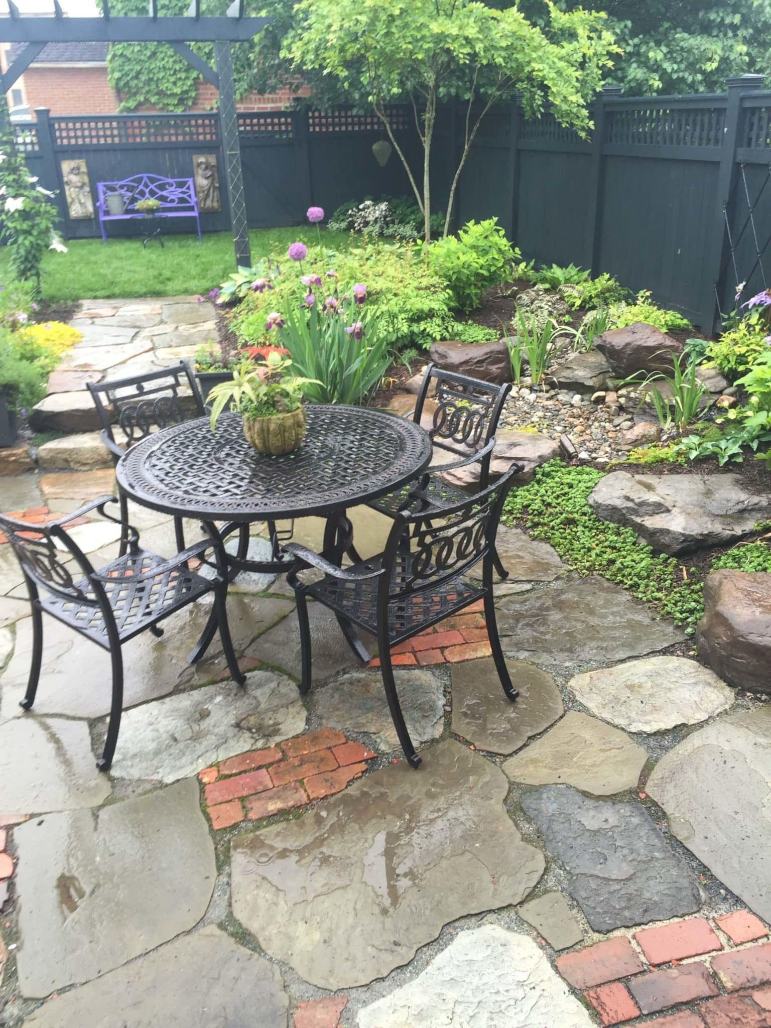 670 Informal Patio Featuring Irregular Flagstone, Salvaged Brick and Waterfeature