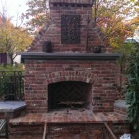 742 Brick Fireplace with Stone Mantle