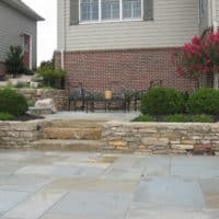 Formal Flagstone Patio with Stone Walls, Built In Grill, Boulders and Potager Garden 5