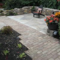 Brick Walkway Leads to Flagstone Patio and Stone Garden Garden Wall