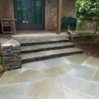 Renovated Front Steps Feature Stone Wall and Irregular Flagstone