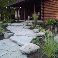 Informal Front Walkway with Boulders and Stone Slab Steppers
