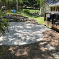 Flagstone Patio off Deck with Boulders