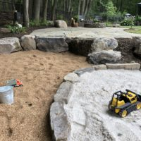 Flagstone Patio, Natural Sand Box and Gravel Pit Play Space