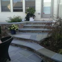 Stone and Flagstone Steps with Integrated Stone Walls