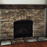 Stone Wall Fireplace Done by Poole's Stone and Garden in Bethesda MD