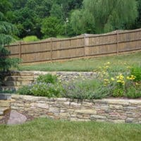 Terraced Gardens Features Stone Retaining Walls and Oakmont Steppers